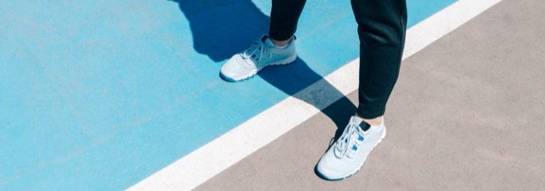 standing on pickleball court with sneakers on